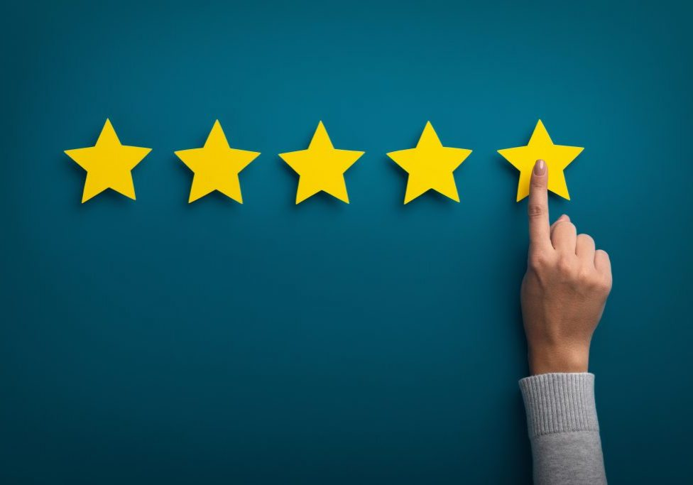 Customer,Experience,Concept.,Woman,Hand,Showing,On,Five,Star,Excellent